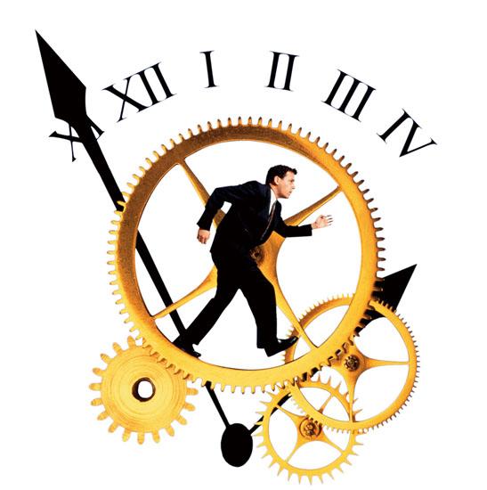 Businessman running on clock gears